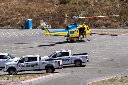 A search helicopter takes off to look for missing US actress Naya Rivera on Lake Piru as searches continue after her disappearance while boating with her young son in Los Padres National Forest, California, USA, 10 July 2020. Rivera starred in the 'Glee' television show, and went missing after renting a boat and going out on the lake with her four-year-old son on 08 July.
