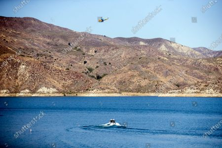 A search helicopter looks for missing US actress Naya Rivera on Lake Piru as searches continue after her disappearance while boating with her young son in Los Padres National Forest, California, USA, 10 July 2020. Rivera starred in the 'Glee' television show, and went missing after renting a boat and going out on the lake with her four-year-old son on 08 July.