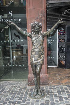 Stock Photo of Cilla Black Statue outside the original enterance to The Famous Cavern Club and Cavern Pub, Matthew St