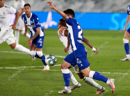 "Stock Picture of Real Madrid CF's Rodrygo Goes and Alberto Rodriguez ""Tachi"" (Deportivo Alaves) are seen in action during the La Liga match round 35 between Real Madrid and Deportivo Alaves at Sportcity of Valdebebas in Madrid. (Final score; Real Madrid 2:0 Deportivo Alaves)"