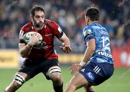 Crusaders Samuel Whitelock run sat Blues Harry Plummer, right, during the Super Rugby Aotearoa rugby game between the Crusaders and the Blues in Christchurch, New Zealand