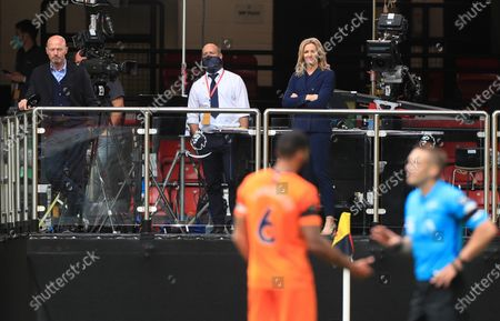 Tv pundits Alan Shearer (L) and Gaby Logan watch the action during the English Premier League match between Watford and Newcastle United in Watford, Britain, 11 July 2020.
