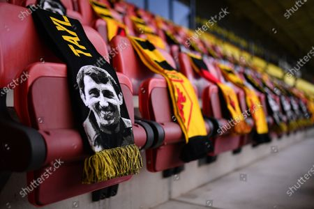 The portrait of former Watford manager Graham Taylor is featured on scards placed on seats in the stands before the English Premier League match between Watford and Newcastle United in Watford, Britain, 11 July 2020.