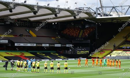 Players observe a minute of silence to remember former English international Jack Charlton before the English Premier League match between Norwich City and West Ham United in Norwich, Britain, 11 July 2020. Charlton passed away 10 July 2020.