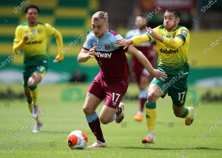 Emiliano Buendia (R) of Norwich in action against Jarrod Bowen of West Ham during the English Premier League match between Norwich City and West Ham United in Norwich, Britain, 11 July 2020.