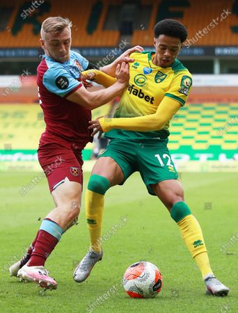 Jamal Lewis (R) of Norwich in action against Jarrod Bowen of West Ham during the English Premier League match between Norwich City and West Ham United in Norwich, Britain, 11 July 2020.