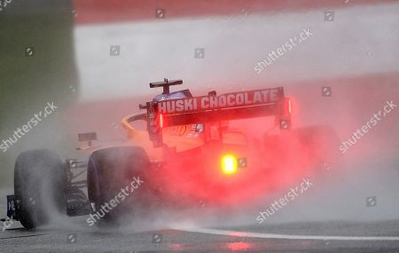 Mclaren driver Carlos Sainz of Spain steers his car during the qualifying session for the Styrian Formula One Grand Prix at the Red Bull Ring racetrack in Spielberg, Austria, Saturday, July 11, 2020. The Styrian F1 Grand Prix will be held on Sunday. (Joe Klamar/Pool via AP)