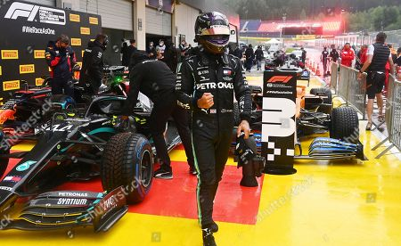 Mercedes driver Lewis Hamilton of Britain celebrates after clocking the fastest time during the qualifying session for the Styrian Formula One Grand Prix at the Red Bull Ring racetrack in Spielberg, Austria, Saturday, July 11, 2020. The Styrian F1 Grand Prix will be held on Sunday. (Joe Klamar/Pool via AP)