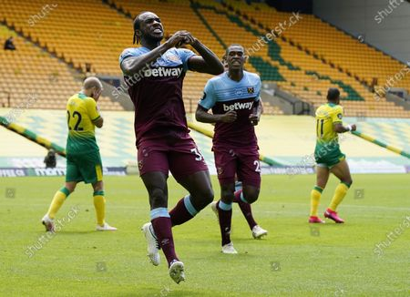 Michail Antonio of West Ham celebrates after scoring his second goal during the English Premier League match between Norwich City and West Ham United in Norwich, Britain, 11 July 2020.