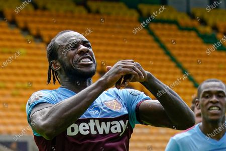 West Ham's Michail Antonio celebrates after scoring his side's second goal during the English Premier League soccer match between Norwich City and West Ham at the Carrow Road stadium in Norwich, England