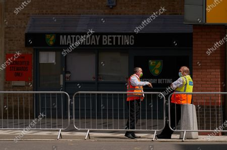 Norwich City Stewards wearing PPE / face masks stand guard outside of Carrow Road. Norwich City play West Ham United in a Project Restart match behind closed doors.