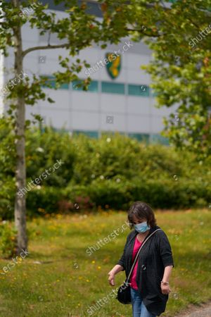 A passerby wearing PPE / Face Mask waslks past Carrow Road. Norwich City play West Ham United in a Project Restart match behind closed doors.
