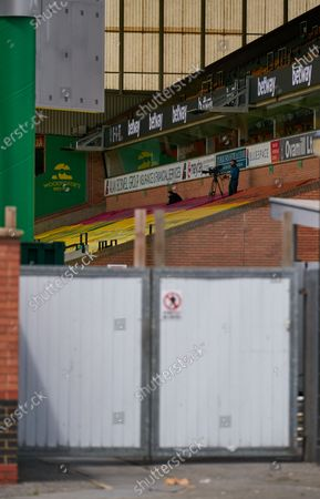 A lone camera operator films match action inside of Carrow Road. Norwich City play West Ham United in a Project Restart match behind closed doors.