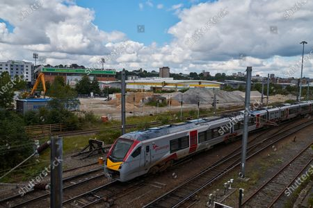 A Greater Anglian train heads away from Norwich Train Station and past Carrow Road, ahead of the Project Restart match against West Ham United