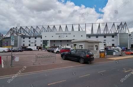 A car makes its way to a security checkpoint outside of Carrow Road, as a security guard wears PPE / Face Mask and checks credentials of the driver. Norwich City play West Ham United in a Project Restart match behind closed doors.