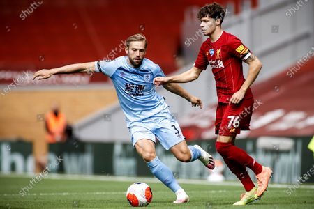 Liverpool's Neco Williams (R) in action against Burnley's Charlie Taylor (L) during the English Premier League soccer match between Liverpool FC and Burnley FC in Liverpool, Britain, 11 July 2020.