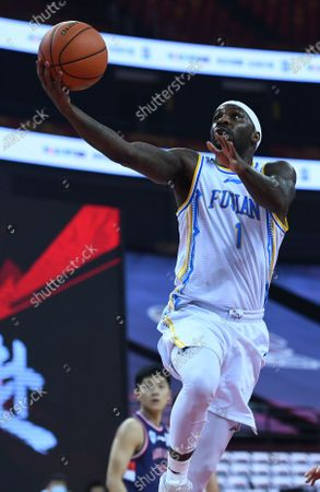 Ty Lawson of Fujian Sturgeons goes for a basket during a match between Fujian Sturgeons and Guangzhou Loong Lions at the 2019-2020 Chinese Basketball Association (CBA) league in Qingdao, east China's Shandong Province, July 11, 2020.