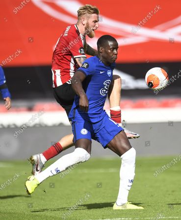 Oli McBurnie of Sheffield (L) in action against Kurt Zouma of Chelsea (R) during the English Premier League match between Sheffield United and Chelsea in Sheffield, Britain, 11 July 2020.