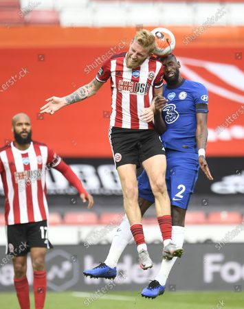 Oli McBurnie of Sheffield (C) in action against Antonio Rudiger of Chelsea (R) during the English Premier League match between Sheffield United and Chelsea in Sheffield, Britain, 11 July 2020.