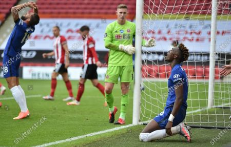 Tammy Abraham of Chelsea (R) reacts after missing a chance to score during the English Premier League match between Sheffield United and Chelsea in Sheffield, Britain, 11 July 2020.