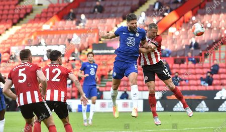 Olivier Giroud of Chelsea (2-R) wins the header during the English Premier League match between Sheffield United and Chelsea in Sheffield, Britain, 11 July 2020.