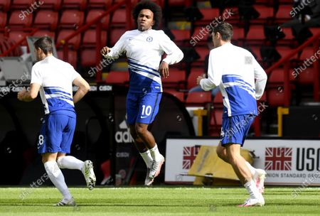 Willian of Chelsea (C) warms up ahead of the English Premier League match between Sheffield United and Chelsea in Sheffield, Britain, 11 July 2020.