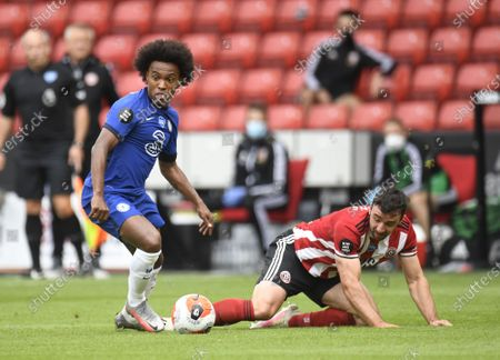 Enda Stevens of Sheffield (R) in action against Willian of Chelsea (L) during the English Premier League match between Sheffield United and Chelsea in Sheffield, Britain, 11 July 2020.