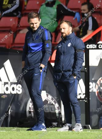 Chelsea's manager Frank Lampard (L) speaks to his assistant Jody Morris (R) during the English Premier League match between Sheffield United and Chelsea in Sheffield, Britain, 11 July 2020.
