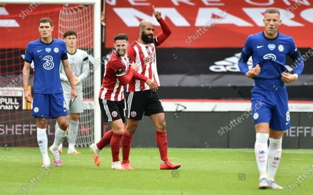 David McGoldrick of Sheffield (C) is being congratulated by team mates after scoring the opening goal during the English Premier League match between Sheffield United and Chelsea in Sheffield, Britain, 11 July 2020.