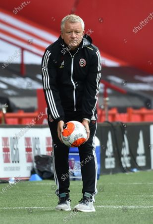 Sheffield's manager manager Chris Wilder picks the ball during the English Premier League match between Sheffield United and Chelsea in Sheffield, Britain, 11 July 2020.