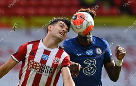 John Egan of Sheffield (L) in action against Tammy Abraham of Chelsea (R) during the English Premier League match between Sheffield United and Chelsea in Sheffield, Britain, 11 July 2020.