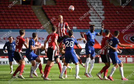 Oli McBurnie of Sheffield (C) wins the header during the English Premier League match between Sheffield United and Chelsea in Sheffield, Britain, 11 July 2020.