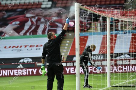 Ground staff disinfect the goal during the English Premier League match between Sheffield United and Chelsea in Sheffield, Britain, 11 July 2020.
