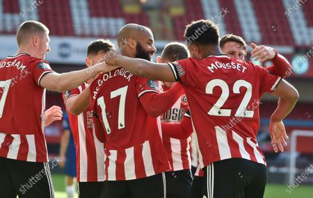 David McGoldrick of Sheffield (C) celebrates with team mates after scoring the third goal during the English Premier League match between Sheffield United and Chelsea in Sheffield, Britain, 11 July 2020