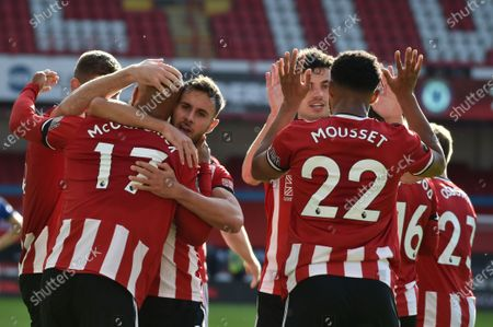 David McGoldrick of Sheffield (L) celebrates with team mates after scoring the third goal during the English Premier League match between Sheffield United and Chelsea in Sheffield, Britain, 11 July 2020