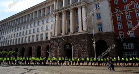 """Police officers stand guard in front of the Council of Ministers during a protest in Sofia, Bulgaria, 11 July 2020.  Thousands of Bulgarians gathered in downtown Sofia for another day in support of President Rumen Radev, who called for """"cleansing of power confiscated by the mafia."""" The Prosecutor's office took over the presidency on 08 July 2020 searching the offices of the president's secretary for legal affairs and anti-corruption Plamen Uzunov and security and defense consultant Iliya Milushev, after which the two were arrested and charged with crimes to limit influence, among others, which led to protests in support of the president."""