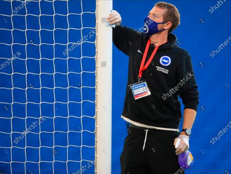 A staff member disinfects the goal post during the English Premier League match between Brighton & Hove Albion and Manchester City in Brighton, Britain, 11 July 2020.