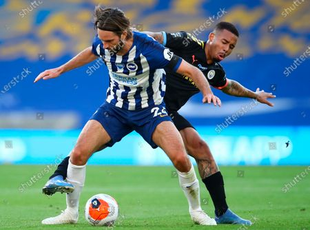 Brighton's Davy Propper (L) in action against Manchester City's Gabriel Jesus (R) during the English Premier League match between Brighton & Hove Albion and Manchester City in Brighton, Britain, 11 July 2020.