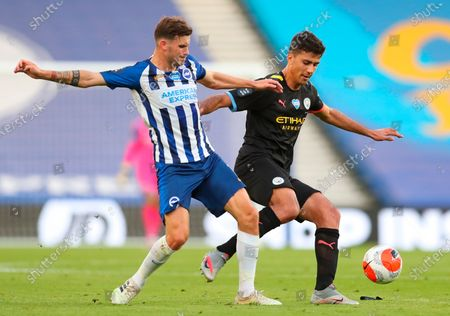 Manchester City's Rodrigo (R) in action against Brighton's Pascal Gross (L) during the English Premier League match between Brighton & Hove Albion and Manchester City in Brighton, Britain, 11 July 2020.