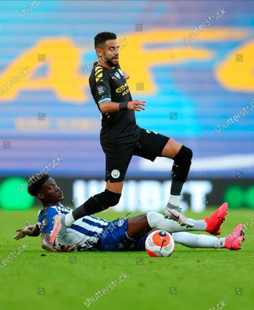 Manchester City's Riyad Mahrez (up) in action against Brighton's Yves Bissouma (down) during the English Premier League match between Brighton & Hove Albion and Manchester City in Brighton, Britain, 11 July 2020.