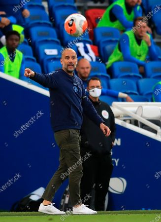 Manchester City manager Pep Guardiola gestures during the English Premier League match between Brighton & Hove Albion and Manchester City in Brighton, Britain, 11 July 2020.