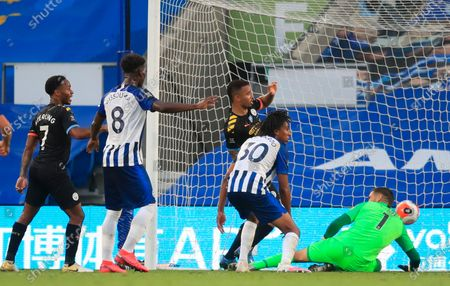 Manchester City's Gabriel Jesus (C)  scores for a 2-0 lead during the English Premier League match between Brighton & Hove Albion and Manchester City in Brighton, Britain, 11 July 2020.