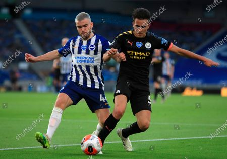Manchester City's Eric Garcia (R) in action against Brighton's Aaron Connolly (L) during the English Premier League match between Brighton & Hove Albion and Manchester City in Brighton, Britain, 11 July 2020.