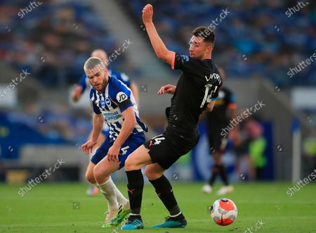 Manchester City's Aymeric Laporte (R) in action against Brighton's Aaron Connolly (L) during the English Premier League match between Brighton & Hove Albion and Manchester City in Brighton, Britain, 11 July 2020.