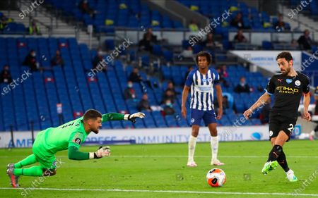 Manchester City's Bernardo Silva (R) scores for a 4-0 lead during the English Premier League match between Brighton & Hove Albion and Manchester City in Brighton, Britain, 11 July 2020.