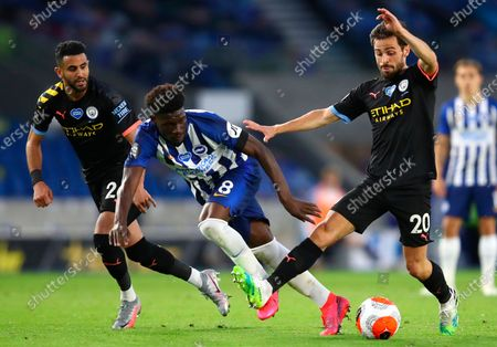 Manchester City's Bernardo Silva (R) in action against Brighton's Yves Bissouma (C) during the English Premier League match between Brighton & Hove Albion and Manchester City in Brighton, Britain, 11 July 2020.