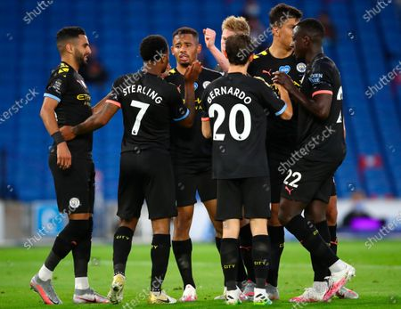 Manchester City's Raheem Sterling (2-L) celebrates with teammates after scoring for a 3-0 lead during the English Premier League match between Brighton & Hove Albion and Manchester City in Brighton, Britain, 11 July 2020.