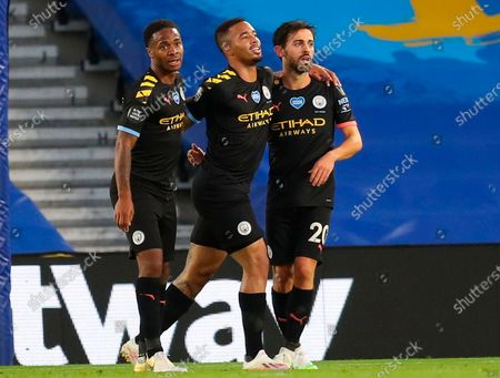 Manchester City's Bernardo Silva (R) celebrates after scoring for a 4-0 lead with Manchester City's Raheem Sterling (L) and Gabriel Jesus (C) during the English Premier League match between Brighton & Hove Albion and Manchester City in Brighton, Britain, 11 July 2020.