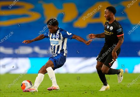 Brighton's Tariq Lamptey (L) in action against Manchester City's Raheem Sterling (R) during the English Premier League match between Brighton & Hove Albion and Manchester City in Brighton, Britain, 11 July 2020.