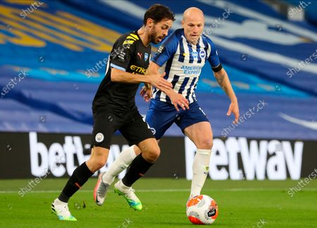 Manchester City's Bernardo Silva (L) in action against Brighton's Aaron Mooy (R) during the English Premier League match between Brighton & Hove Albion and Manchester City in Brighton, Britain, 11 July 2020.